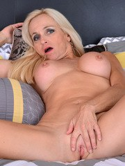 Canadian housewife Dani Dare is hot as hell in a bra miniskirt and garter stockings.
