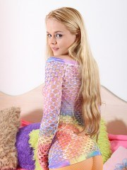 Orange fishnets and a rainbow top