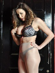 Hot busty Milf Nylon Jane is teasing at the door in stunning red high heels and gorgeous