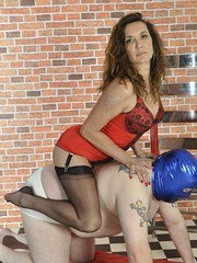 Hot Milf Nylon Jane uses gimp as a foot stool as he helps her into a sexy pair of