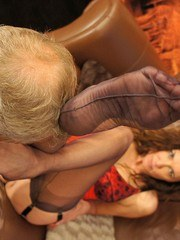 Nylon Jane encases her foot slaves mouth with her long nylon legs and sexy feet as