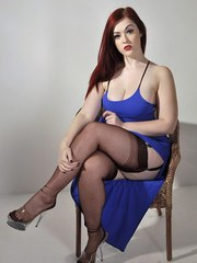Gorgeous curvy redhead Jay shows off her sexy nylon hold-ups and a lovely blue party