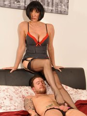 Jane slips her nylon covered feet around a hard cock and wanks it slowly.