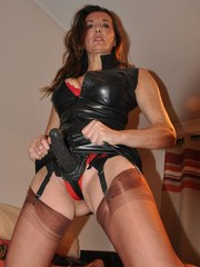 Jane is hiding a big sex toy between her nylon covered legs and it looks fucking