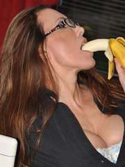 Nylon Jane is dressed in gorgeous stockings and is seductively eating a banana.