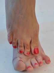 Nylon Jane shows off her very sexy feet on this foot play shoot.