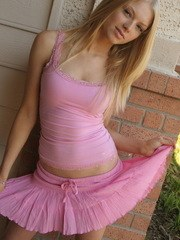 Cute blonde teen Skye teases with her perky tits outside in her pink top and short