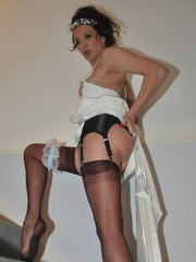 Jane is dressed in a gorgeous wedding dress and playing with her pussy