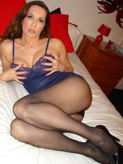 Sexy Jane in blue lingerie rubs her big strapon surprise