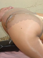 Jane poses outside in pantyhose and gets a load over her ass