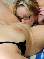 she squirts a ton too. She ends up squirting all over my face and down my big milf