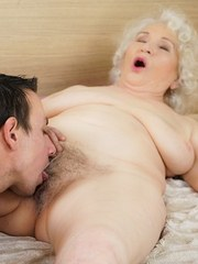 Busty granny Norma shared a bed with young Rob. She already knows that his young