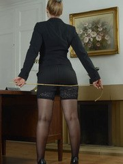 Deputy Headmistress Drogan is wearing a tight black suit over black lingerie lace