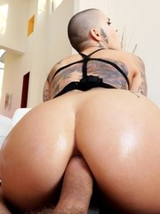 Leigh Raven is pierced and covered in tattoos from head to toe. The slender alt-porn