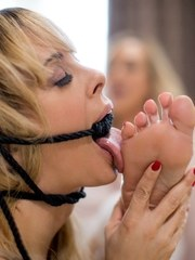 Brandi Love comes home and kicks off her heels after a hard day at work. She puts