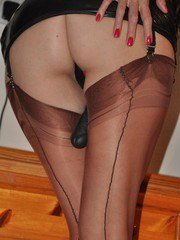 Strapon Jane slips in to a sultry pair of nylon stockings and a bit of leather to