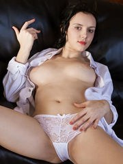 Anatali shows off her beautiful tits and smooth pussy on the chair.