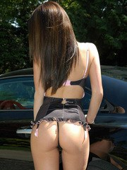 Sexy Kate is outdoors in a very sexy lingerie outfit by her car showing off her tight