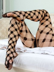 Sporting stunning fishnet stockings Anee Ocean is an attention grabbing redhead!