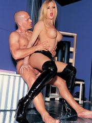 Babes in latex boots and corsets are fucked hard in the ass