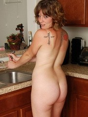 Sexy hot babe Misty strips naked in the kitchen and cools off when she sprays her