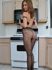 Busty babe Chrissy Marie is cooking up something hot as she strips out of her fishnet