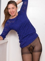 Valentine is wearing her sexy blue dress and black stockings looking quite hot. She
