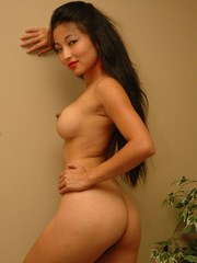 Tiny asian Aria Lee strips out of her red fishnet dress and lace panties