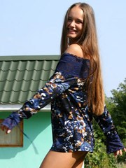 Happy and smiling teen sasha plays and teases in a navy one piece dress thingy