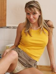 Cute Denisa gets naked in the kitchen
