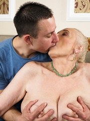 Busty granny Sila wants to please a young man! She may be old but she still knows