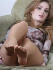 Faye shows off her cute feet in pantyhose
