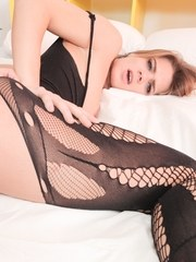 Young Budapest cutie Lara West is all dolled up in her fishnet bodysuit for a penetrating