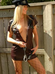 Alicia plays a naughty officer!