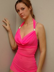 Amy shows off her perfect body in a bright pink dress