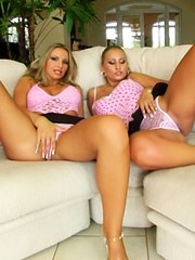 Two sexy blondes get banged on a white couch and then swap some sperm