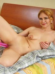 Lush Russian housewife Adelis Shaman peels off her panties and squeezes her nipples