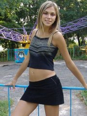 Sweet brunette flashing goodies in a merry go round