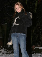 Kristin outdoors at night in the snow