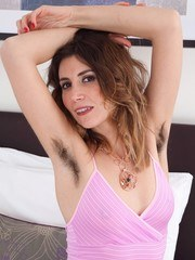 Terri Rose is sexy in bed and eager to show off her hairy pits and pussy. She strips