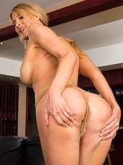 Busty mature babe Anna Kelly strips nakes in the hotel bar.