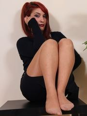 Gorgeous redhead in sher pantyhose shows her soft soles