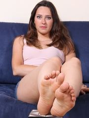 Hot brunette shows her perfect soles