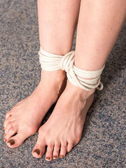 Soles writing torture for a hogtied girl - photos