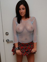 Krissy shows off her huge tits in a fishnet top