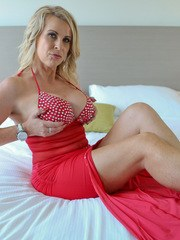 Busty mom Sammi Rox is looking fine in an evening gown that highlights her huge tits