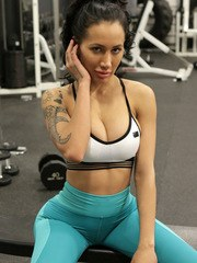 Enhanced busty athlete Amia Miley is quick to snap selfies of herself in the gym