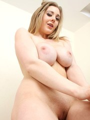 Naughty blonde babe shows off her large tits