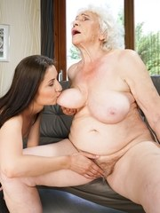 Horny granny Norma and sexy young Linda Love spend a hot lesbian moment together.