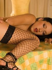 Sexy brunette babe in fishnets sucks a cock they gets fucked